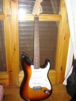 Squier by fender and peavey guitar - $100 (Denver)